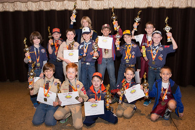 Cub Scout Pack 1099 Pinewood Derby winners pose with their Den Award trophies.