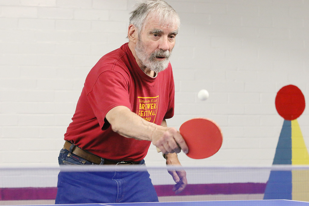 . Ken Jones, 82, plays some ping pong at the Fitchburg Senior Center on Thursday, May 18, 2017. SENTINEL & ENTERPRISE/JOHN LOVE