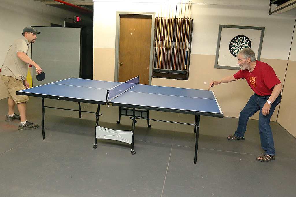 . Ken Jones, 82 on right, plays some ping pong with Nick Squailia, 36, at the Fitchburg Senior Center on Thursday, May 18, 2017. SENTINEL & ENTERPRISE/JOHN LOVE