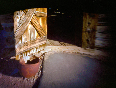Toll Cabin Doorway - This is a single shutter/pinhole exposure.  The shutter only opened half way and this rendition resulted.  The curved black area at the top is the shutter.  I think it provides a nice framing.