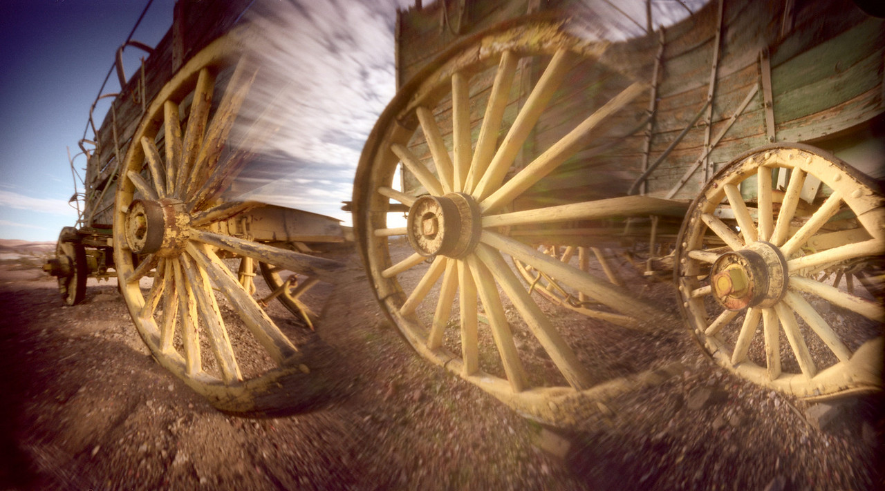 """""""Wheels of Time""""  The Abelson Scopeworks Hexomniscope camera was used.  Individual shutters were selectively used to merge these old wagon wheels.  Clark County Museum, Henderson, NV."""