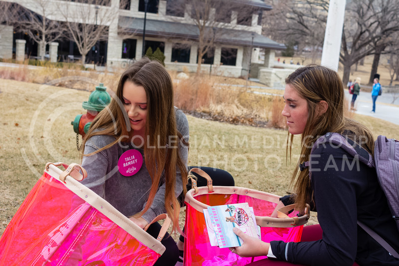 """Pink Campus Rep, Talia Ramsey sophomore in Hospitality Management held a panty frenzy event. Pink sent them 100 pairs if panties to give out on campus, """"we're supposed to create a frenzy in campus by hinting at the event and time if the giveaway, and then revealing our location on campus right at the time of the event, causing girls to frenzy and come find us!"""" said Talia Ramsey. The hint for this event was """"roses are red violets are blue come get your panties by the spork-like statue"""" (Alex Shaw Collegian Media Group)"""