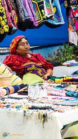 Guna woman selling molas in Panama City Panama