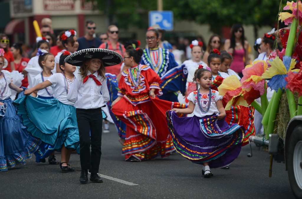 . Marigold Elementary School students dance their way down Main St. during the Pioneer Day Parade, May 5, 2018,  in Chico, California. (Carin Dorghalli -- Enterprise-Record)