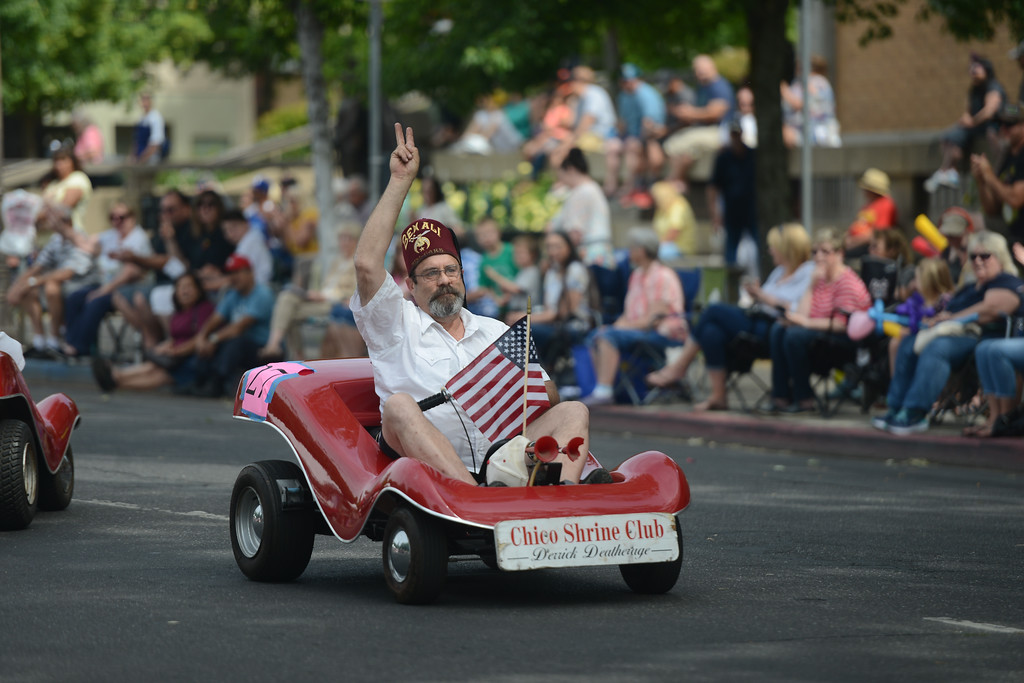 . Derrick Deatherage of Chico Shrine Club rides his go cart during the Pioneer Day Parade, May 5, 2018,  in Chico, California. (Carin Dorghalli -- Enterprise-Record)