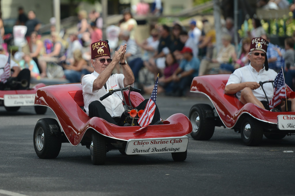. Darrell Deatherage of the Chico Shrine Club rides his go cart during the Pioneer Day Parade, May 5, 2018,  in Chico, California. (Carin Dorghalli -- Enterprise-Record)