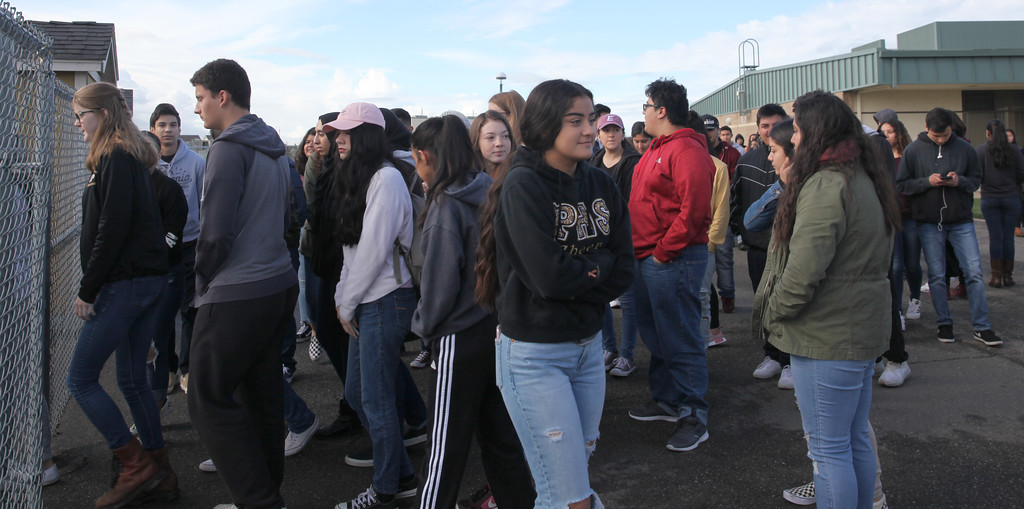 . CINTIA LOPEZ - DAILY DEMOCRAT Students at Pioneer High School wait to enter the football field. At 10 a.m. they exited their classrooms in protest of gun violence during a nationwide school walkout.