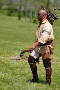Stock image of an American Indian reenactor at the  re-enactment of the Ruddle's Station Massacre in Kentucky USA.  In 1780, during the Revolutionary War, British and Indian troops attacked the station in present-day Harrison County. Twenty settlers were killed; survivors were marched to Detroit and held for the rest of the war.