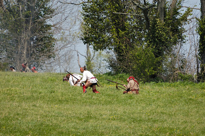 Stock image of American Indian Warrior re-enactors attacking settlers at the re-enactment of the Ruddle's Station Massacre in Kentucky USA.  In 1780, during the Revolutionary War, British and Indian troops attacked the station in present-day Harrison County. Twenty settlers were killed; survivors were marched to Detroit and held for the rest of the war.
