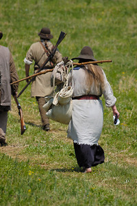 Stock image of pioneers at the re-enactment of the Ruddle's Station Massacre in Kentucky USA.  In 1780, during the Revolutionary War, British and Indian troops attacked the station in present-day Harrison County. Twenty settlers were killed; survivors were marched to Detroit and held for the rest of the war.