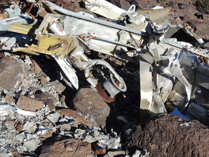 The aircraft had a post crash fire. This tire was burned off. See the melted aluminum?