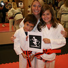 Miranda and Gavin,Miranda and Gavin receive their Karate advance orange belt from their Sensei Shannon.
