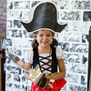 Camila Tiru, 5, wears her best pirate garb during pirate day at the Fitchburg Public Library on Tuesday afternoon. SENTINEL & ENTERPRISE / Ashley Green