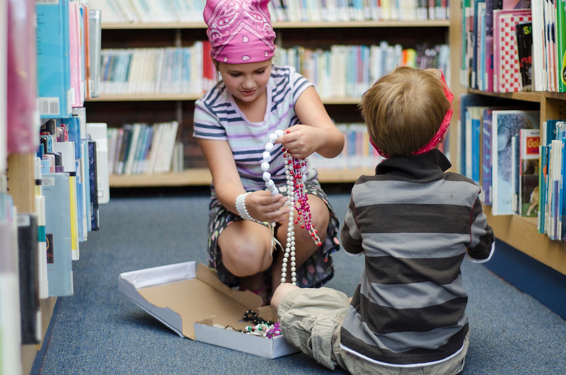 Alexis French, 8 and Hunter French, 6, find treasure during the treasure hunt at pirate day at the Fitchburg Public Library on Tuesday afternoon. SENTINEL & ENTERPRISE / Ashley Green