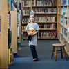 Emily Steffen, 5, hunts for treasure between the bookshelves during pirate day at the Fitchburg Public Library on Tuesday afternoon. SENTINEL & ENTERPRISE / Ashley Green