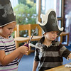 Alexis French, 8, and Hunter French, 6, create pirate swords during pirate day at the Fitchburg Public Library on Tuesday afternoon. SENTINEL & ENTERPRISE / Ashley Green