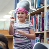 Alexis French, 8, shows off her findings from the treasure hunt during pirate day at the Fitchburg Public Library on Tuesday afternoon. SENTINEL & ENTERPRISE / Ashley Green