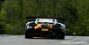 #9 McLaren crests T2A in flames
