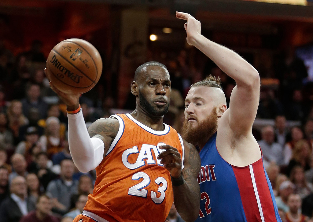 . Cleveland Cavaliers\' LeBron James (23) drives against Detroit Pistons\' Aron Baynes (12), from New Zealand, in the first half of an NBA basketball game, Tuesday, March 14, 2017, in Cleveland. (AP Photo/Tony Dejak)