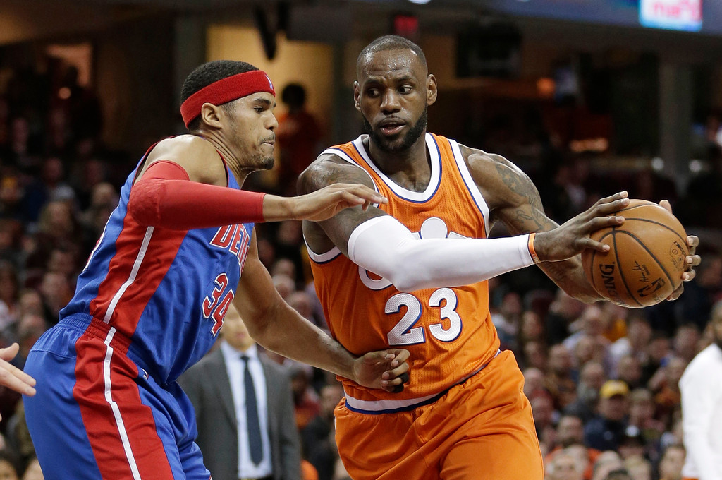 . Cleveland Cavaliers\' LeBron James (23) drives past Detroit Pistons\' Tobias Harris (34) in the first half of an NBA basketball game, Tuesday, March 14, 2017, in Cleveland. (AP Photo/Tony Dejak)