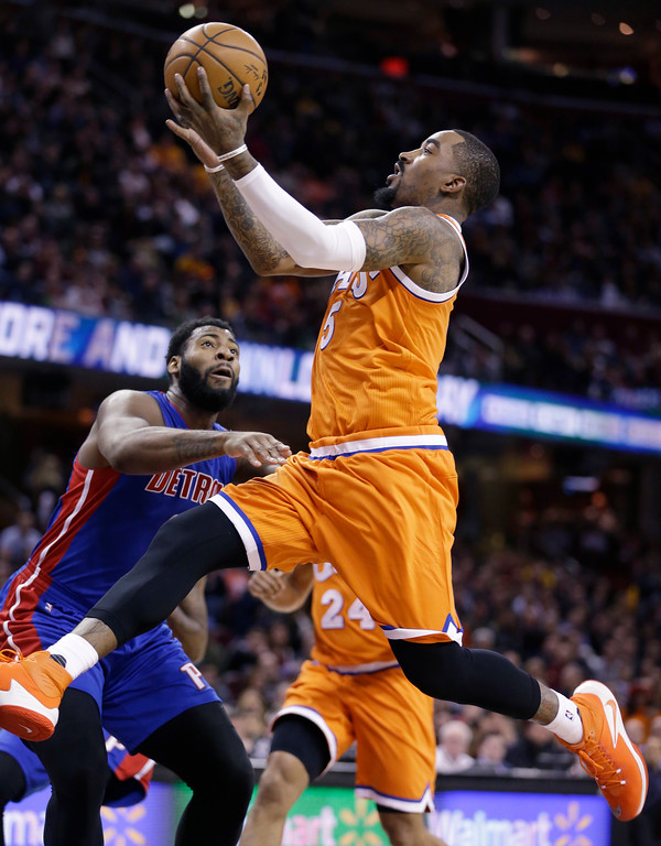 . Cleveland Cavaliers\' J.R. Smith, right, drives to the basket Detroit Pistons\' Andre Drummond in the first half of an NBA basketball game, Tuesday, March 14, 2017, in Cleveland. (AP Photo/Tony Dejak)