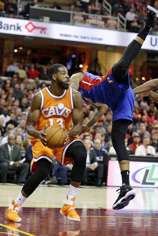 . Cleveland Cavaliers\' Tristan Thompson, left, looks to pass under defense by Detroit Pistons\' Marcus Morris, right, in the first half of an NBA basketball game, Tuesday, March 14, 2017, in Cleveland. (AP Photo/Tony Dejak)