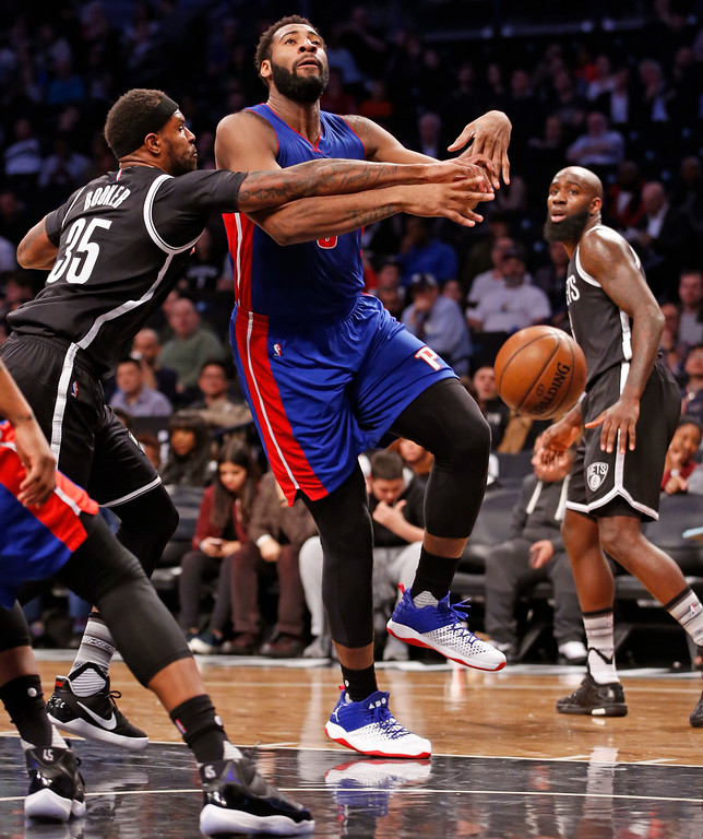 . Brooklyn Nets forward Trevor Booker (35) fouls Detroit Pistons center Andre Drummond (0) during the first half of an NBA basketball game, Tuesday, March 21, 2017, in New York. (AP Photo/Kathy Willens)