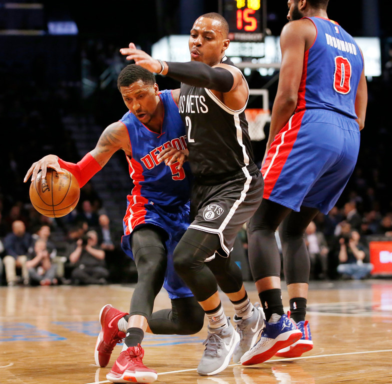 . Detroit Pistons guard Kentavious Caldwell-Pope (5) drives up against Brooklyn Nets guard Randy Foye (2) as Pistons center Andre Drummond (0) looks on during the first half of an NBA basketball game, Tuesday, March 21, 2017, in New York. (AP Photo/Kathy Willens)