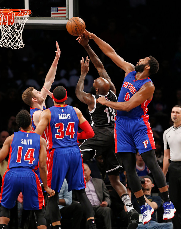. Detroit Pistons center Andre Drummond (0) defends Brooklyn Nets forward Quincy Acy (13) during the first half of an NBA basketball game, Tuesday, March 21, 2017, in New York. (AP Photo/Kathy Willens)