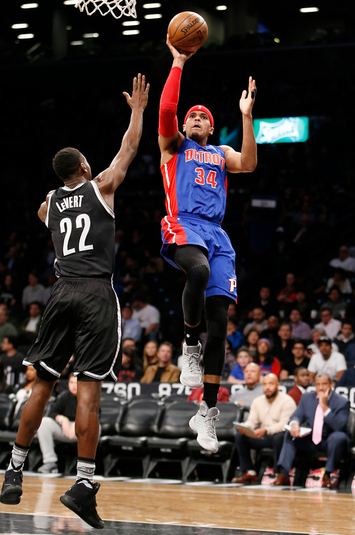 . Brooklyn Nets guard Caris LeVert (22) defends as Detroit Pistons forward Tobias Harris (34) goes up for a layup during the first half of an NBA basketball game, Tuesday, March 21, 2017, in New York. (AP Photo/Kathy Willens)