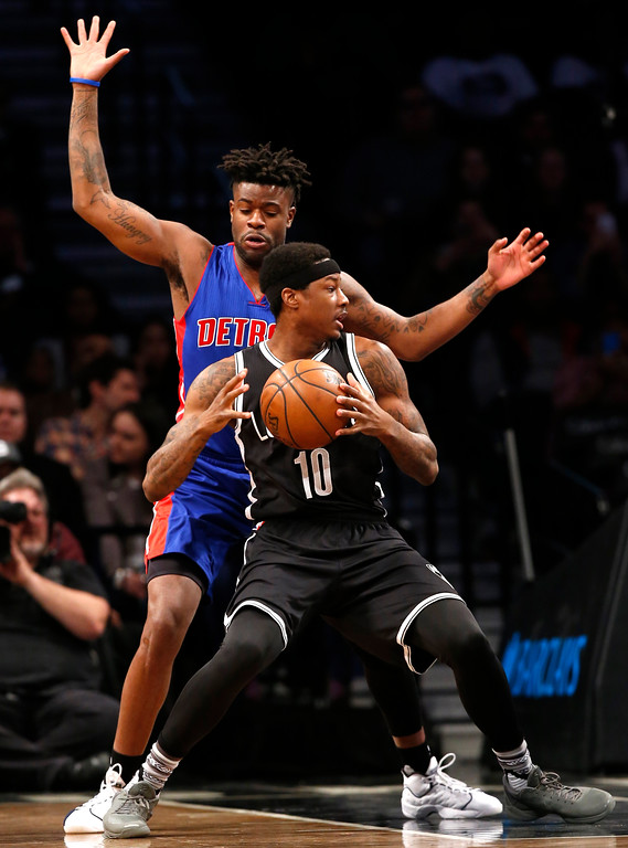 . Detroit Pistons forward Reggie Bullock (25) defends Brooklyn Nets guard Archie Goodwin (10) during the first half of an NBA basketball game, Tuesday, March 21, 2017, in New York. (AP Photo/Kathy Willens)