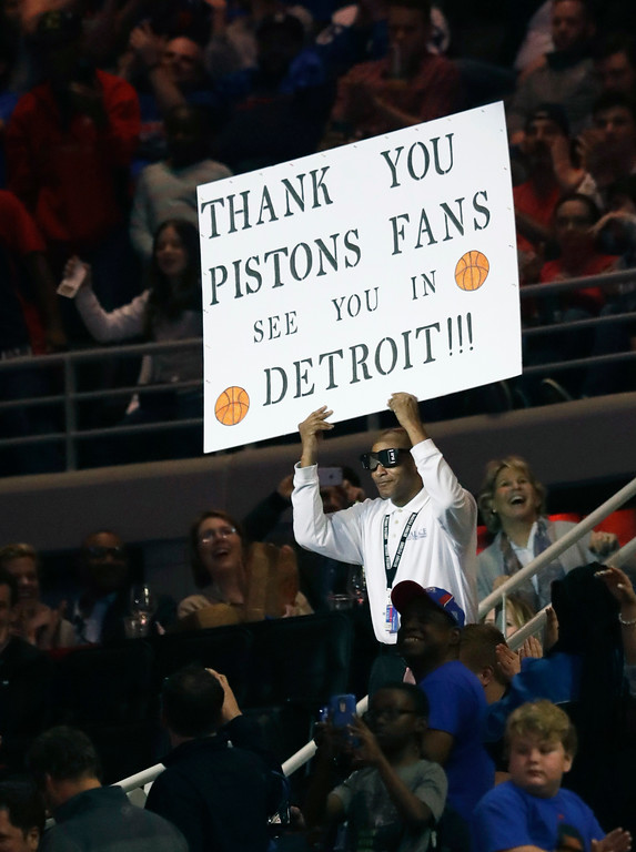. Detroit Pistons dancing usher Shannon Sailes holds up a sign thanking Pistons fans in the second half of an NBA basketball game against the Washington Wizards, Monday, April 10, 2017, in Auburn Hills, Mich. The game tonight was the last Pistons game at the Palace before moving to downtown Detroit next season. (AP Photo/Carlos Osorio)