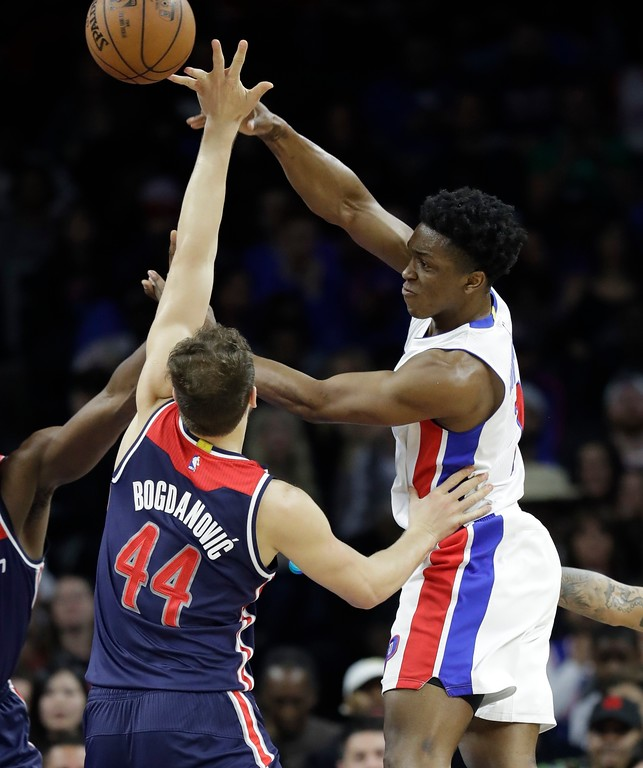 . Detroit Pistons forward Stanley Johnson passes over Washington Wizards guard Bojan Bogdanovic (44) during second half of an NBA basketball game, Monday, April 10, 2017, in Auburn Hills, Mich. (AP Photo/Carlos Osorio)