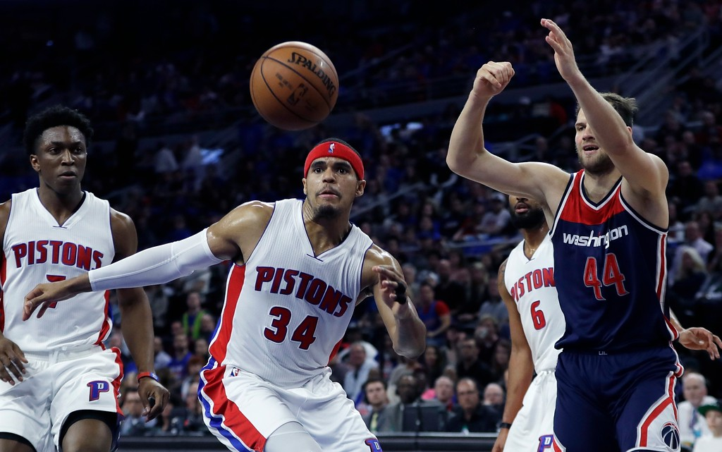 . Detroit Pistons forward Tobias Harris (34) reaches for the rebound ahead of Washington Wizards guard Bojan Bogdanovic (44) during the second half of an NBA basketball game, Monday, April 10, 2017, in Auburn Hills, Mich. (AP Photo/Carlos Osorio)