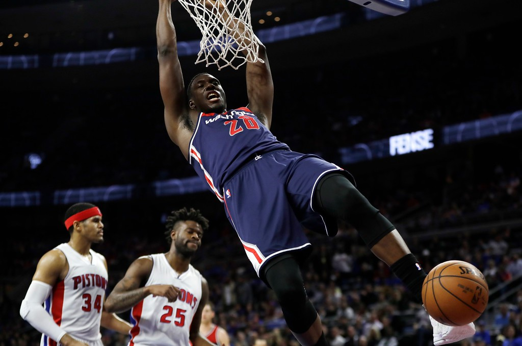 . Washington Wizards center Ian Mahinmi dunks during second half of an NBA basketball game against the Detroit Pistons, Monday, April 10, 2017, in Auburn Hills, Mich. (AP Photo/Carlos Osorio)