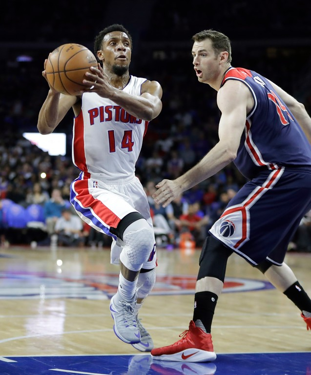 . Detroit Pistons guard Ish Smith (14) drives on Washington Wizards forward Jason Smith during the first half of an NBA basketball game, Monday, April 10, 2017, in Auburn Hills, Mich. (AP Photo/Carlos Osorio)