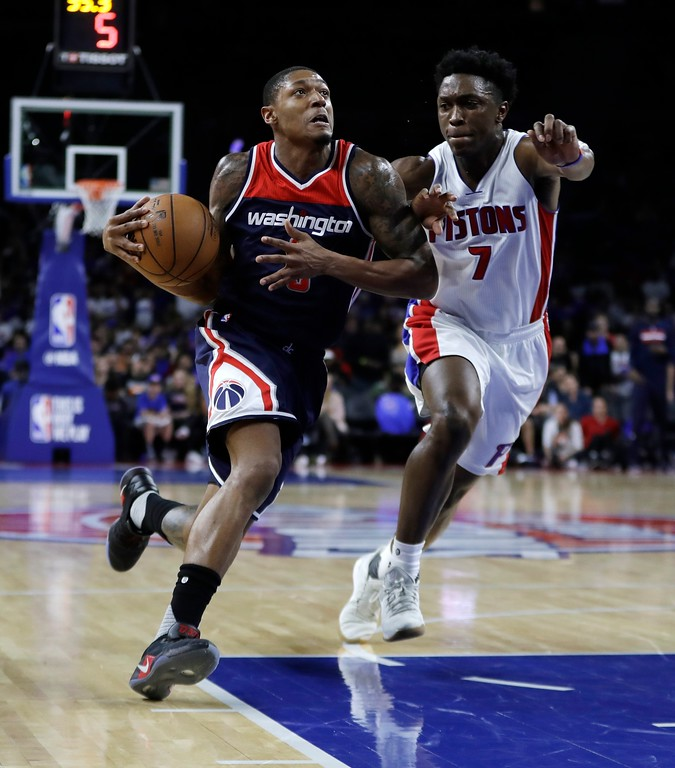 . Washington Wizards guard Bradley Beal (3) drives on Detroit Pistons forward Stanley Johnson (7) during second half of an NBA basketball game, Monday, April 10, 2017, in Auburn Hills, Mich. (AP Photo/Carlos Osorio)