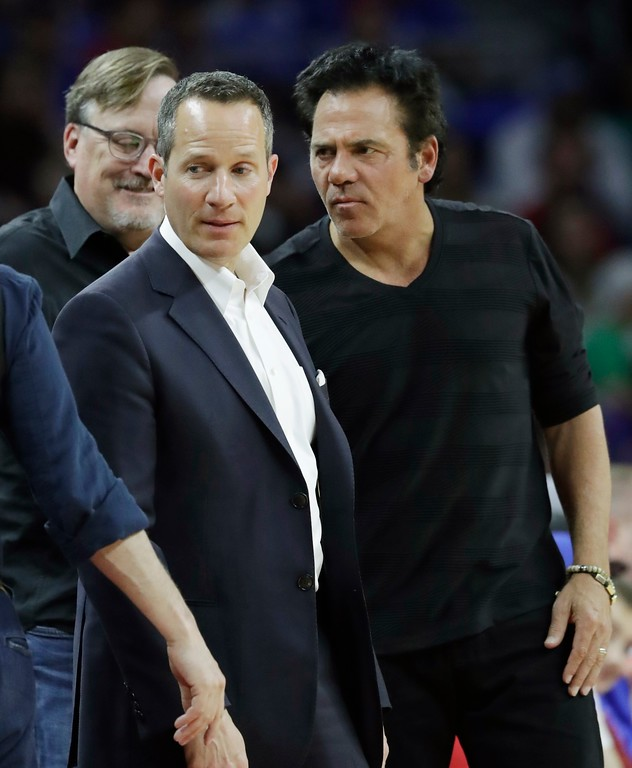 . Christopher Ilitch, president and CEO of Ilitch Holdings, left, and Detroit Pistons owner Tom Gores meet at half court during the first half of an NBA basketball game between the Pistons and the Washington Wizards, Monday, April 10, 2017, in Auburn Hills, Mich.(AP Photo/Carlos Osorio)