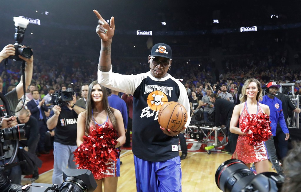 . Former Detroit Pistons player Dennis Rodman delivers the game ball before the first half of an NBA basketball game against the Washington Wizards, Monday, April 10, 2017, in Auburn Hills, Mich. Rodman delivered the ball on the last Pistons game at The Palace before the team moves to downtown Detroit. (AP Photo/Carlos Osorio)