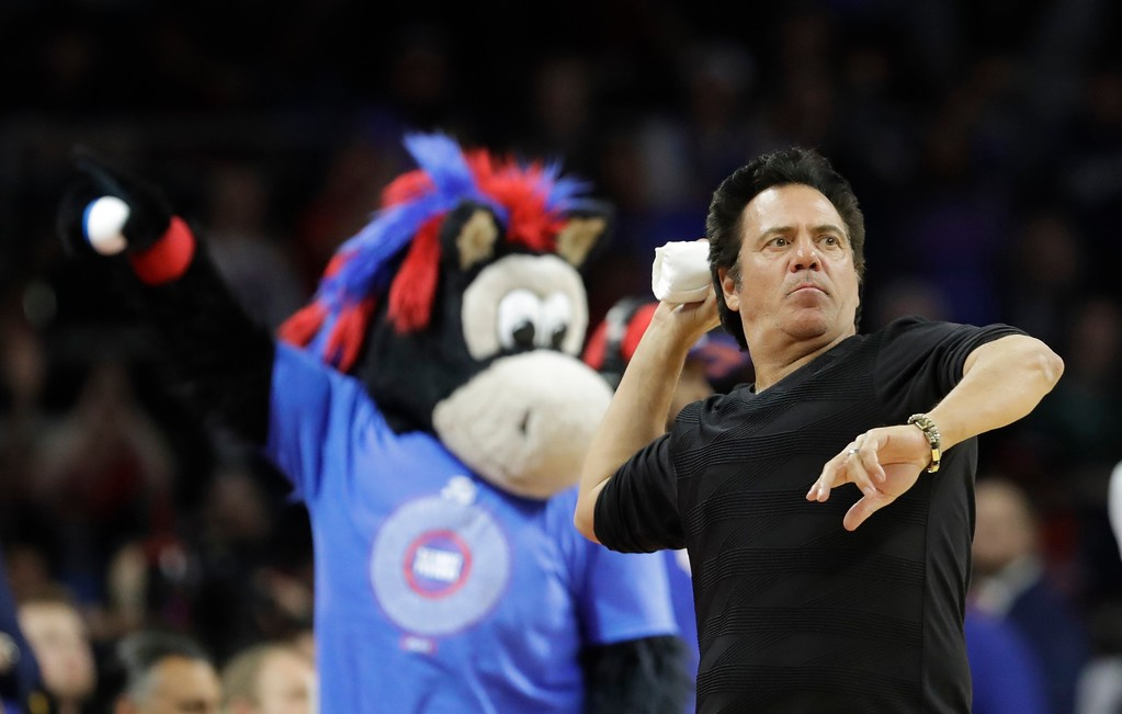. Detroit Pistons owner Tom Gores tosses out T-Shirts during second half of an NBA basketball game against the Washington Wizards, Monday, April 10, 2017, in Auburn Hills, Mich. (AP Photo/Carlos Osorio)
