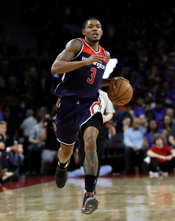 . Washington Wizards guard Bradley Beal brings the ball up court during the second half of an NBA basketball game against the Detroit Pistons, Monday, April 10, 2017, in Auburn Hills, Mich. (AP Photo/Carlos Osorio)