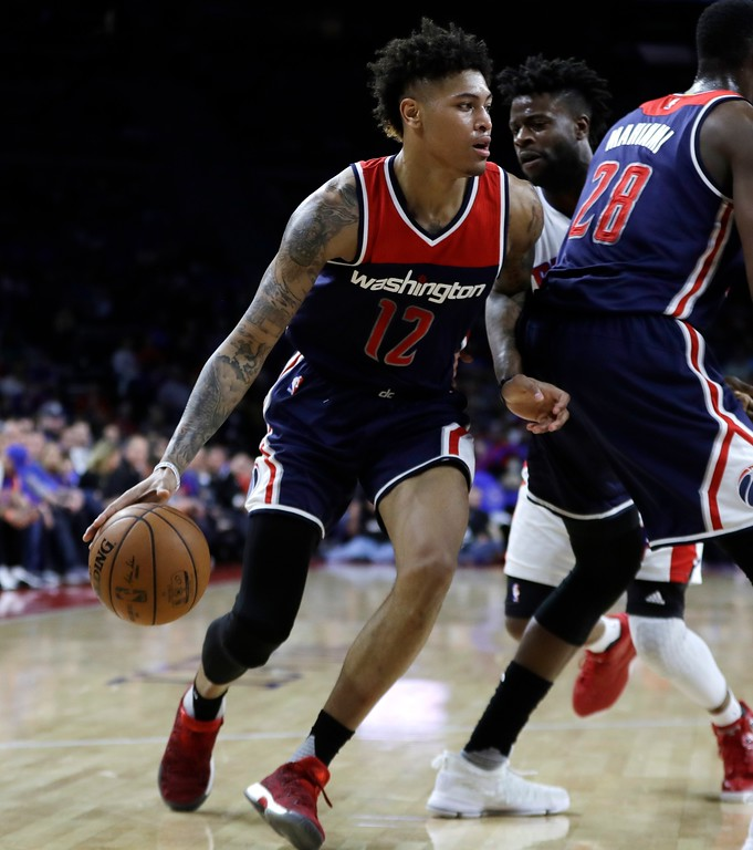 . Washington Wizards forward Kelly Oubre Jr. drives to the basket during the second half of an NBA basketball game against the Detroit Pistons, Monday, April 10, 2017, in Auburn Hills, Mich. (AP Photo/Carlos Osorio)