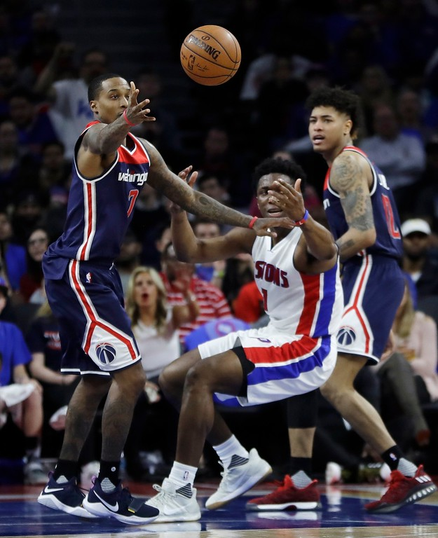. Detroit Pistons forward Stanley Johnson loses control of the ball to Washington Wizards guard Brandon Jennings during second half of an NBA basketball game, Monday, April 10, 2017, in Auburn Hills, Mich. (AP Photo/Carlos Osorio)