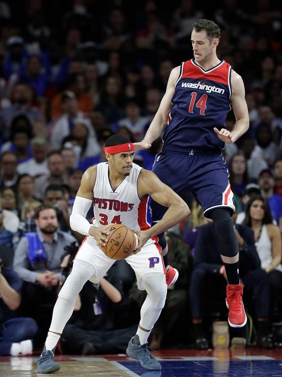 . Detroit Pistons forward Tobias Harris (34) looks around Washington Wizards forward Jason Smith (14) during second half of an NBA basketball game, Monday, April 10, 2017, in Auburn Hills, Mich. (AP Photo/Carlos Osorio)