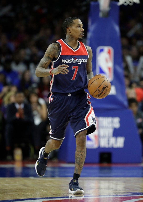. Washington Wizards guard Brandon Jennings brings the ball up court during second half of an NBA basketball game against the Detroit Pistons, Monday, April 10, 2017, in Auburn Hills, Mich. (AP Photo/Carlos Osorio)