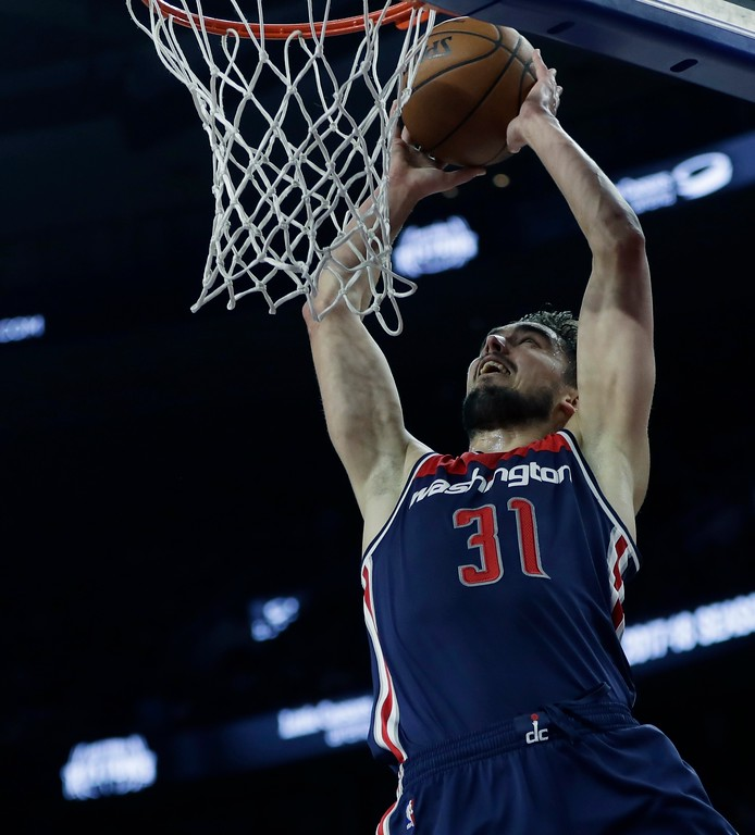 . Washington Wizards guard Tomas Satoransky dunks during the second half of an NBA basketball game against the Detroit Pistons, Monday, April 10, 2017, in Auburn Hills, Mich. (AP Photo/Carlos Osorio)