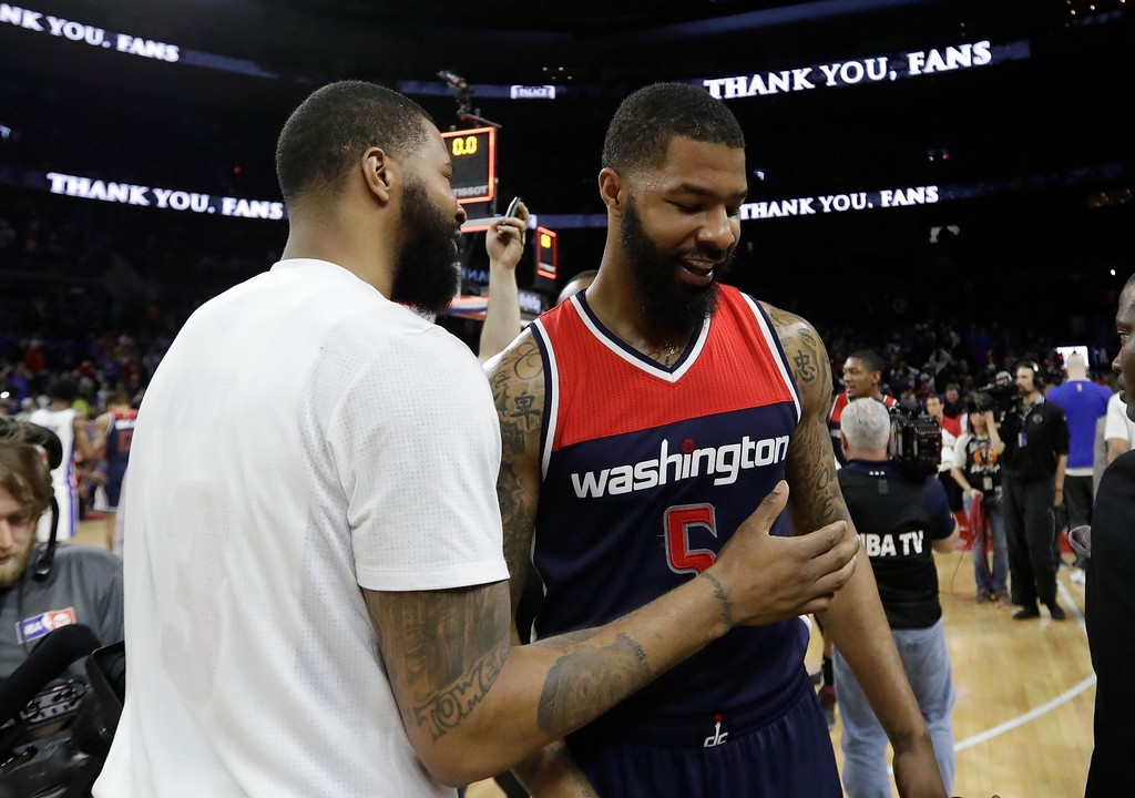 . Detroit Pistons forward Marcus Morris, left, greets his brotherWashington Wizards forward Markieff Morris after an NBA basketball game, Monday, April 10, 2017, in Auburn Hills, Mich. (AP Photo/Carlos Osorio)