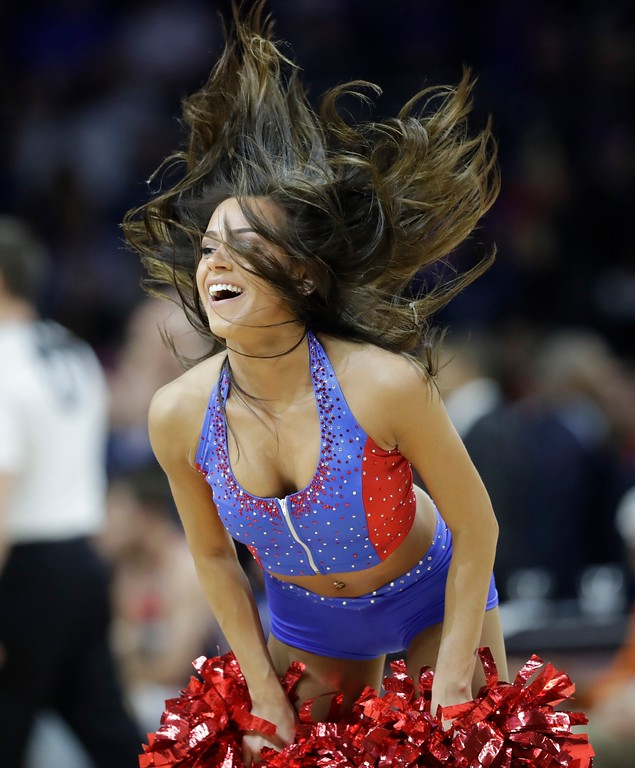 . A Detroit Pistons cheerleader performs during second half of an NBA basketball game against the Washington Wizards, Monday, April 10, 2017, in Auburn Hills, Mich. (AP Photo/Carlos Osorio)