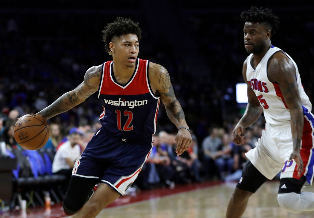 . Washington Wizards forward Kelly Oubre Jr. drives around Detroit Pistons forward Reggie Bullock during the second half of an NBA basketball game, Monday, April 10, 2017, in Auburn Hills, Mich. (AP Photo/Carlos Osorio)