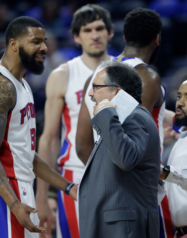 . Detroit Pistons forward Marcus Morris (13) talks with head coach Stan Van Gundy during the first half of an NBA basketball game against the Washington Wizards, Monday, April 10, 2017, in Auburn Hills, Mich. (AP Photo/Carlos Osorio)